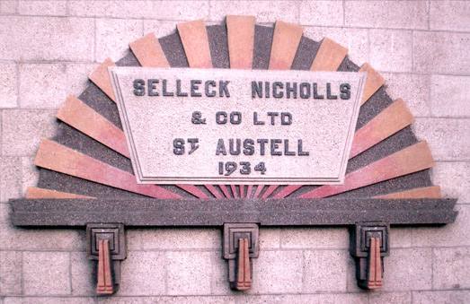 Art deco plaque commemorating the move to their new premises in Par Moor Road, St Austell.